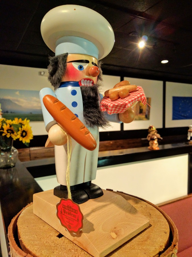 A Nutcracker in the shape of a baker, one of many that adorn the horizontal surfaces and the walls.